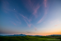 Moon over Tuscan landscape